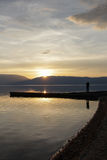 Magnificent scenery .man picturing sunset over lake prespa in macedonia. Image of a Stock Image