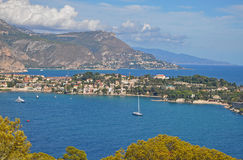 The magnificent scenery of Nice bays, mountains, blue sea and sk Royalty Free Stock Image