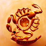 A magnificent Scorpio of gold color bringing good luck and prosperity! stock photography