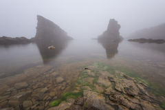 Magnificent seascape over the rock phenomenon The Ships, Sinemorets village, Bulgaria. Foggy weather. Royalty Free Stock Photography