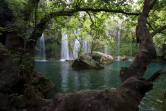 The magnificent Selale Waterfall surrounded by a forest of trees at Antalya in Turkey. Royalty Free Stock Photography