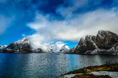 Magnificent snow-covered rocks on a sunny day. Beautiful Norway landscape. Lofoten islands. Stock Photos