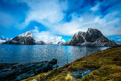 Magnificent snow-covered rocks on a sunny day. Beautiful Norway landscape. Lofoten islands. Stock Image