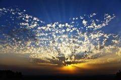 Magnificent sparkling sunset on coast of sea Stock Photos