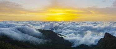 Magnificent spectacle of flowing clouds over the mountains at su Stock Photography