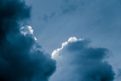 Magnificent storm clouds in the evening sky. High contrast dramatic scenery Stock Photography
