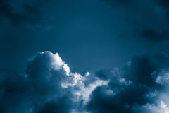Magnificent storm clouds in the evening sky. High contrast dramatic scenery Royalty Free Stock Photo