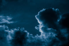 Magnificent storm clouds in the evening sky. High contrast dramatic scenery Stock Images