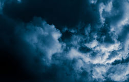Magnificent storm clouds in the evening sky. High contrast dramatic scenery Stock Image