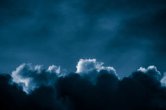 Magnificent storm clouds in the evening sky. High contrast dramatic scenery Royalty Free Stock Image