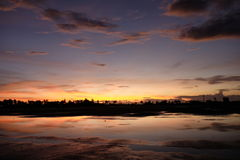 Magnificent sunrise skyline in Kalibo airport in Philippines. Vast and empty field in Kalibo airport. Yellow and red brilliant sun will rise from horizon Stock Image
