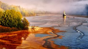 Magnificent sunrise in the Transylvania county in Romania with mist in autumn. Magnificent sunrise in the Carpathian mountains with mist and and waste lake royalty free stock images