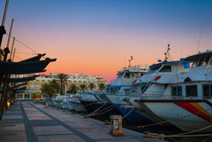 Magnificent sunset color in marina harbor.  End of a warm sunny day in Ibiza, St Antoni de Portmany, Spain. Stock Photo