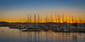 Magnificent sunset color in marina harbor.  End of a warm sunny day in Ibiza, St Antoni de Portmany, Spain. Stock Photos