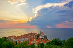 Magnificent sunset over old town of Piran, Slovenia. Splendid summer evening on Adriatic Sea stock photos