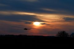 Magnificent sunset with silhouette helicopter Royalty Free Stock Photos