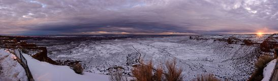 Winter sunset on the top of canyon in Utah USA. Magnificent sunset on the top of canyon top of the Moki Dugway. Infinity prairie extend to the horizon fully Stock Photo