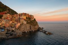Magnificent sunset view of the Manarola village. Manarola is one of the five famous villages in Cinque Terre Five lands National Royalty Free Stock Photo