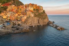 Magnificent sunset view of the Manarola village. Manarola is one of the five famous villages in Cinque Terre Five lands National Royalty Free Stock Photos