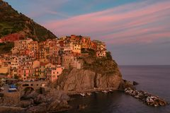 Magnificent sunset view of the Manarola village. Manarola is one of the five famous villages in Cinque Terre Five lands National Royalty Free Stock Photography