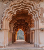 Symmetric arched corridor Stock Image