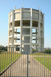 A magnificent very impressive water tower. In a space enclosed and closed by a portal(gate royalty free stock photos