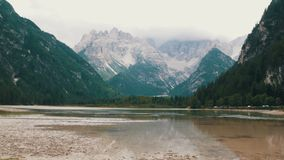 Magnificent view of the Italian Alps and mountain clean lake. Panorama of the mountain nature. Mountain lake in Italy. Magnificent view of the Italian Alps and a stock footage