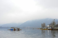 A magnificent view of Kashmir near the lake at Srinagar.A people here using a boat to travel from the other side of lake Stock Image