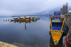A magnificent view of Kashmir near the lake at Srinagar.A people here using a colourfull boat to attract a visitor Royalty Free Stock Photo