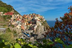 Magnificent daily view of the Manarola village in a sunny summer day. Royalty Free Stock Photos