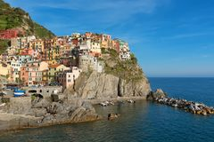 Magnificent daily view of the Manarola village in a sunny summer day. Royalty Free Stock Image