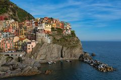 Magnificent daily view of the Manarola village in a sunny summer day. Stock Photos