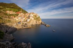 Magnificent daily view of the Manarola village in a sunny summer day. Stock Photo