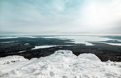 Magnificent view from Mount Kivakka at the mouth of the Olanga River and Lake Piaozero. Winter landscape. Magnificent view from Mount Kivakka at the mouth of the Royalty Free Stock Photos