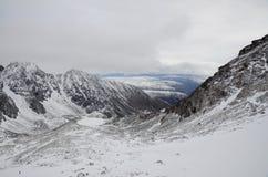 Climbing to the highest peak of the eastern Sayan Munku-Sardyk. Royalty Free Stock Photo