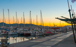 Magnificent warm sunset color in marina harbor.  End of a warm sunny day in Ibiza, St Antoni de Portmany, Spain. Royalty Free Stock Photography