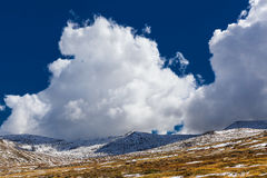 Magnificent white clouds over snow capped Australian Alps. stock images