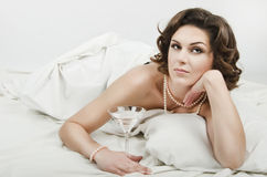 Magnificent woman lying in bed Royalty Free Stock Photography