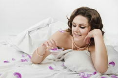 Magnificent woman lying in bed Stock Image
