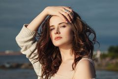 Magnificent Woman Touching her Hand her Hair. Outdoors Portrait Royalty Free Stock Image