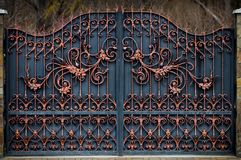 Magnificent wrought-iron gates, ornamental forging, forged elements close-up.  stock photography