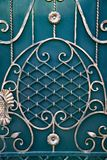 Magnificent wrought-iron gates, ornamental forging, forged elements close-up stock photo