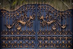 Magnificent wrought-iron gates, ornamental forging, forged elements close-up.  stock photos