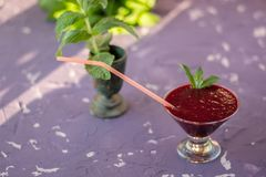Magnificently prepared smoothie in combination with strawberries, currants, cherries and grape juice in glasses. The image of a magnificently prepared smoothie stock images
