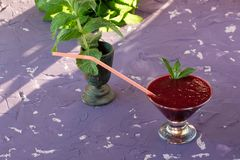 Magnificently prepared smoothie in combination with strawberries, currants, cherries and grape juice in glasses. The image of a magnificently prepared smoothie stock photos