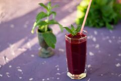 Magnificently prepared smoothie in combination with strawberries, currants, cherries and grape juice in glasses. The image of a magnificently prepared smoothie royalty free stock images