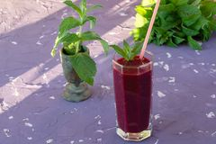Magnificently prepared smoothie in combination with strawberries, currants, cherries and grape juice in glasses. The image of a magnificently prepared smoothie royalty free stock photos