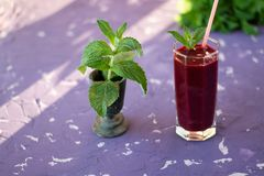 Magnificently prepared smoothie in combination with strawberries, currants, cherries and grape juice in glasses. The image of a magnificently prepared smoothie stock photo