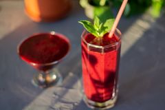 Magnificently prepared smoothie in combination with strawberries, currants, cherries and grape juice in glasses. The image of a magnificently prepared smoothie royalty free stock image