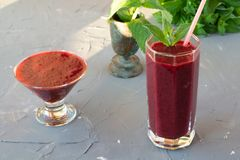 Magnificently prepared smoothie in combination with strawberries, currants, cherries and grape juice in glasses. The image of a magnificently prepared smoothie royalty free stock photo
